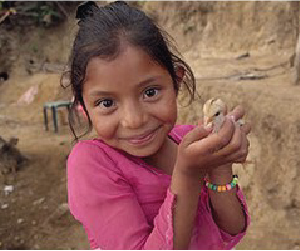 Little girl smiling and holding little chick