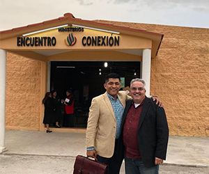 Man and minister in front of the church - John Arcovio Ministries