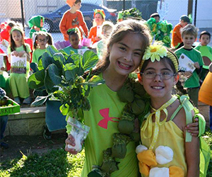 Two little girls in vegetable costumes - Recipe For Success Foundation
