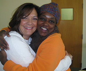 Volunteer and participant hugging after a sharing session - Ignatius Volunteer Corps