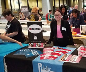 Volunteer at the organization booth - Public Justice Center