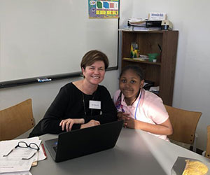 Volunteer tutoring a student - Mercy Education Project