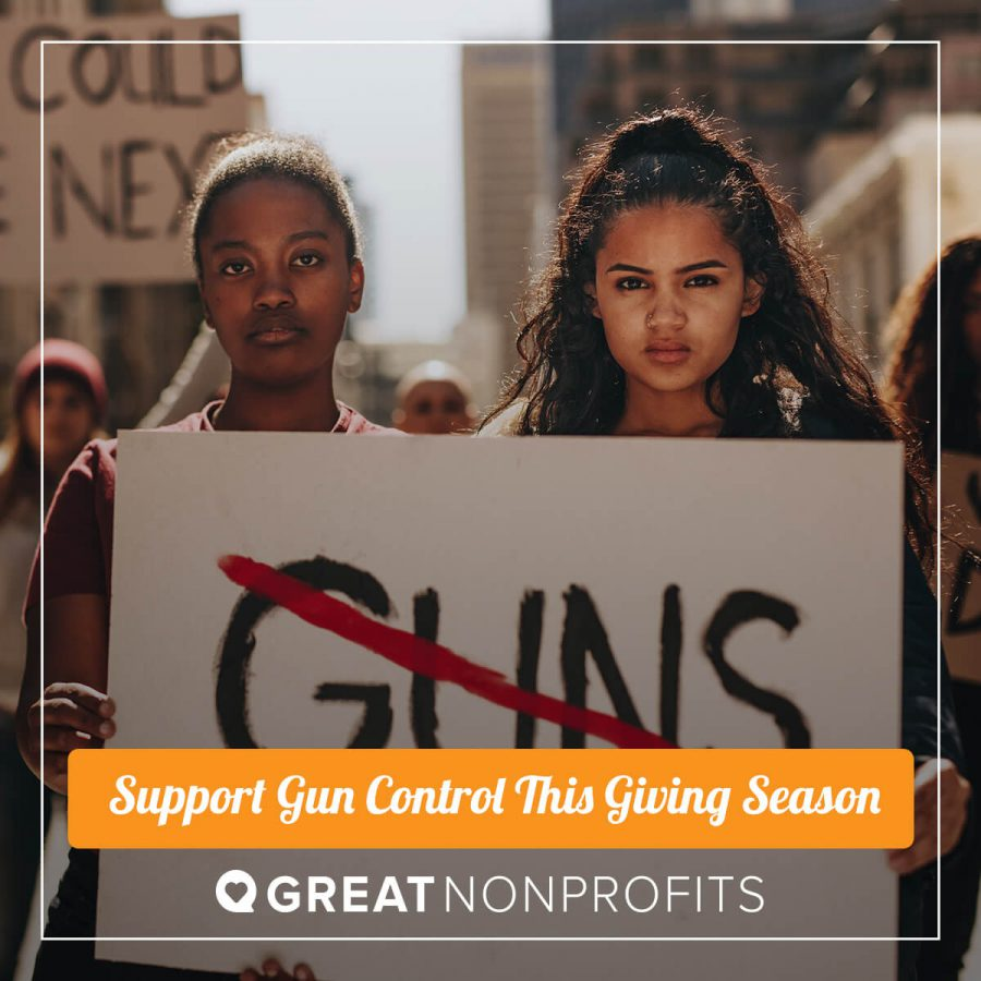 two women of color holding anti-gun sign