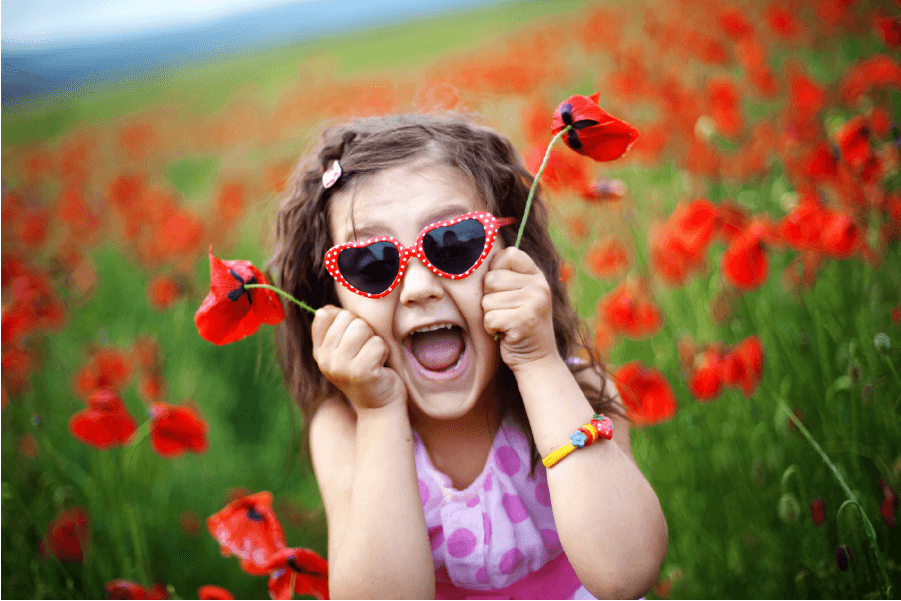 happy girl in red rose field