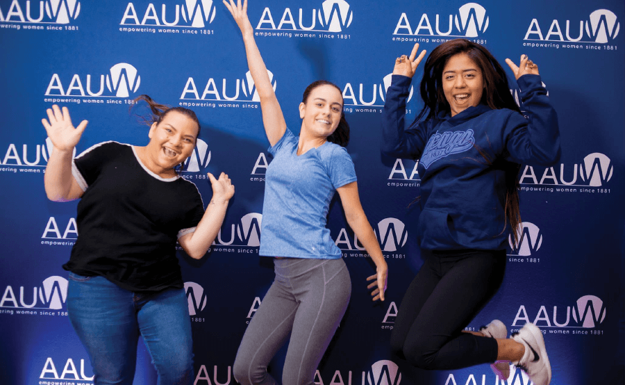 Three Women jumping cheerfully - AAUW