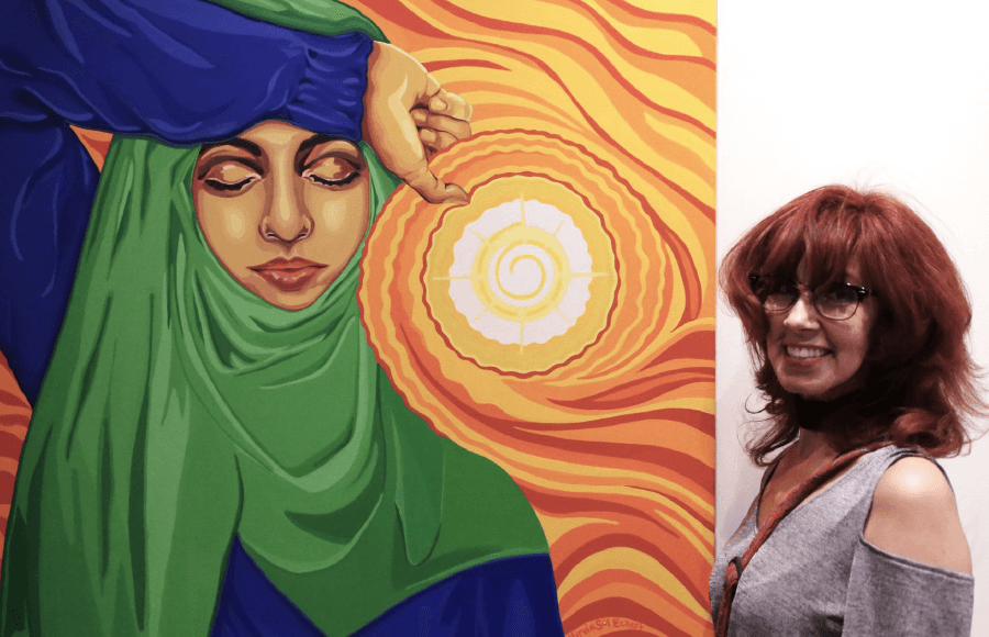 Woman posing infront of her painting of a muslim woman - WMG