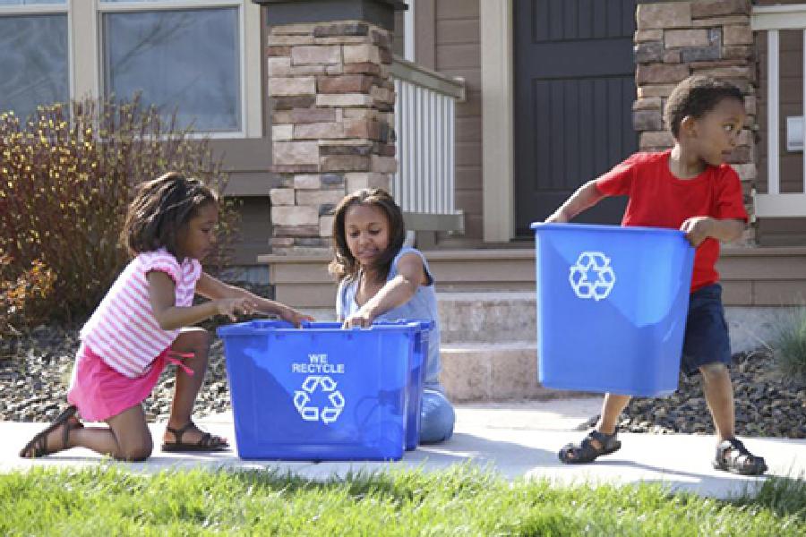 3 children holding Recycle bins - GreatNonprofits