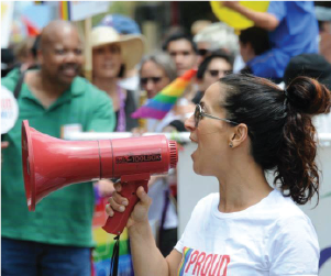 woman using megaphone at pride parade