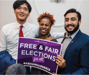 three diverse people holding a sign that says Free & Fair Elections for all