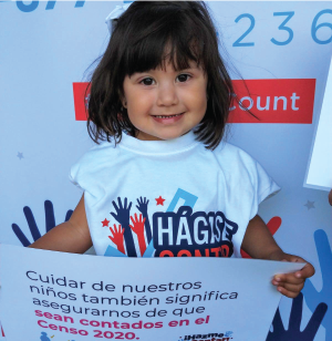 young girl holding a sign about the Census