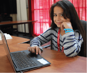 Little girl with her laptop - Tech Corps