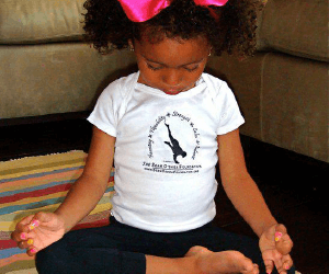 girl with legs crossed in yoga pose