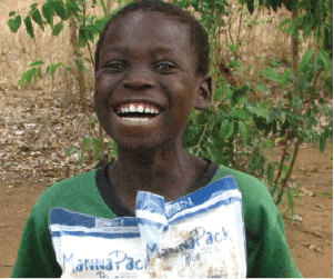 Child happy to receive food The Malawi Project