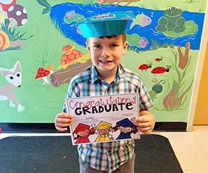 Little boy graduate Childrens Receiving Home Of Sacramento