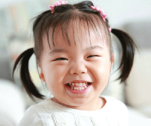 Little toddler smiling Love Without Boundaries Foundation