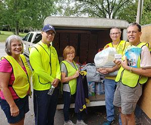 Volunteer preparing donations Layman Lessons Church Ministries
