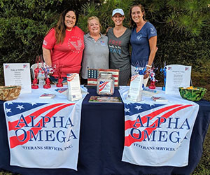 Volunteers at their booth Alpha Omega Veteran Services
