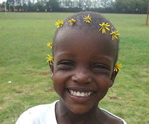 Little girl with flower on her head Bread and Water for Africa