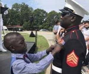 Son pining medal on dad Yellow Ribbon Fund Inc