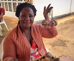 Volunteer making bead crafts BeadforLife