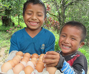 little boys happy to receive food Finding Freedom Through Friendship Inc