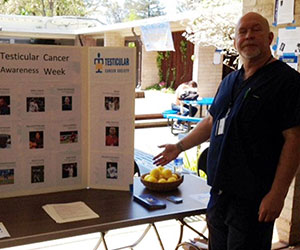 volunteer at their awareness booth Testicular Cancer Society