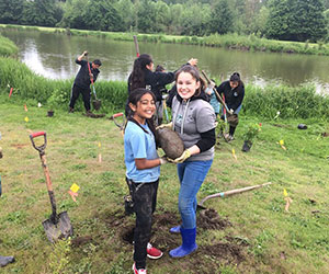 young volunteers at a river clean up River Network