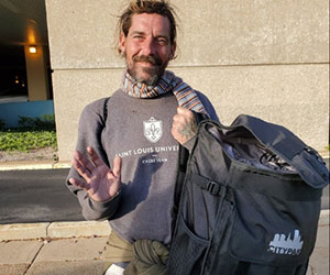 Homeless man received a backpack Back at You