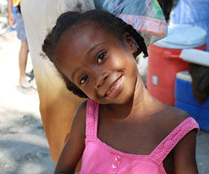 Little Haitian girl smiling Health Ministries for Haiti Inc