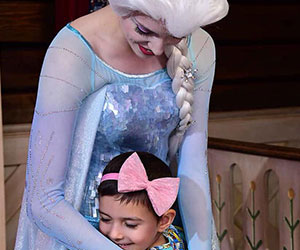 Little girl hugging Elsa Make-A-Wish Arizona