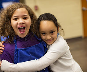 little girls hugging Boys _Girls Clubs of the Twin Cities