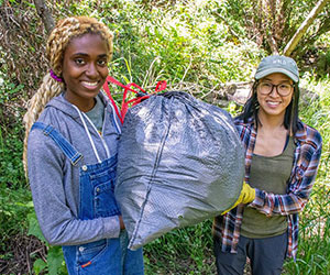 two volunteers clearing out trash at forest clean up Los Padres Forestwatch
