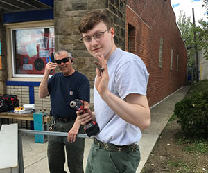 volunteer helping build a little library Brookline Teen Outreach