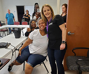 volunteer hugging a participant Saara Of Virginia Inc